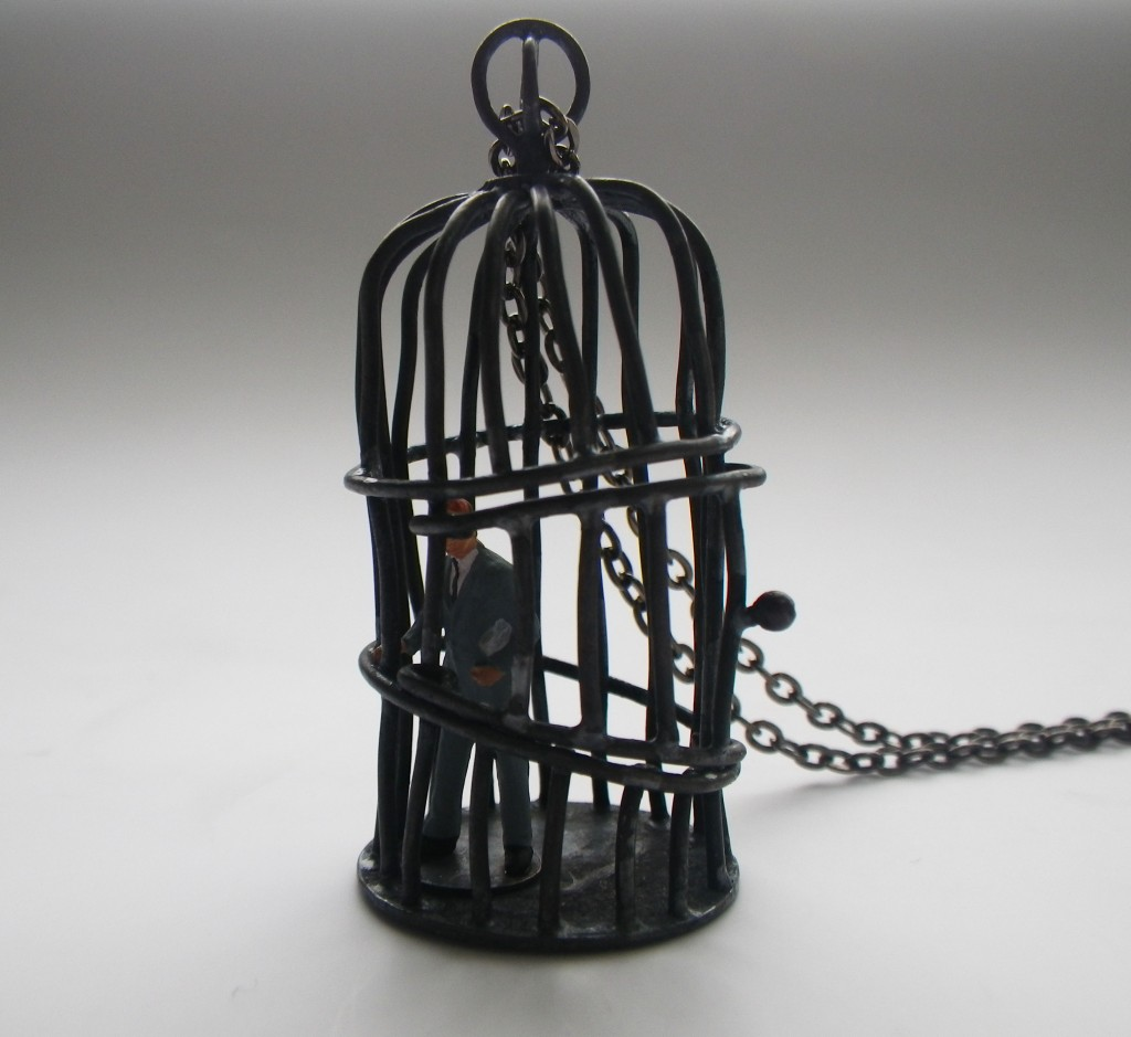bird cage pendant with tiny business man or banker made with oxidised copper wire