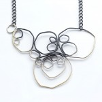 large circle necklace in matte black and grey ombre