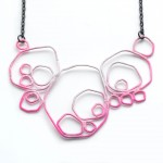 large circle necklace in neon pink and grey gradation