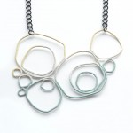 large circle necklace in three colour powder coat