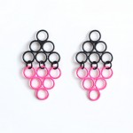 shadow triangle earrings in neon pink and matte black powdercoat