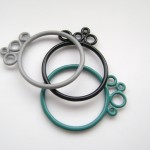 simple stacking bubble rings in grey black and turquoise