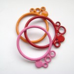 stacking bubble rings in pink, red and orange powdercoat