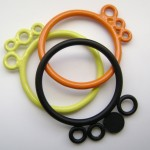 simple stacking bubble rings powdercoated in black, orange and yellow