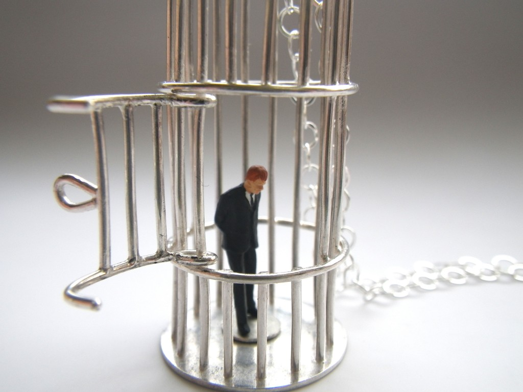 Silver bird cages with small business men or bankers trapped inside