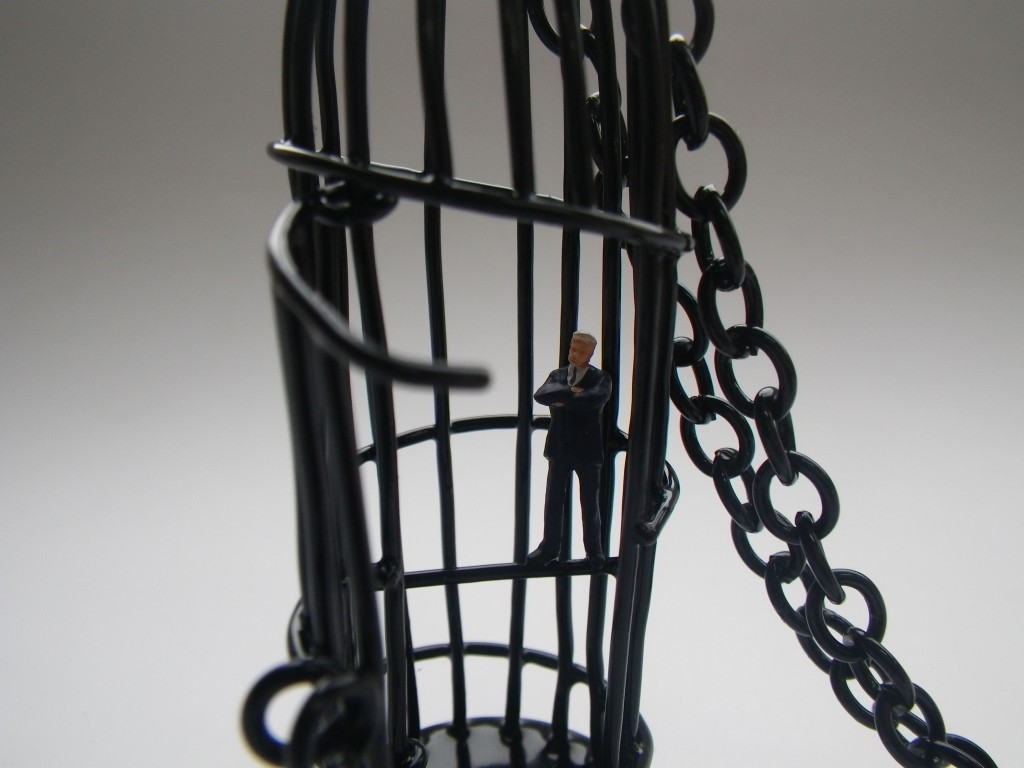 bird cage with tiny business men or bankers, made of powdercoated copper