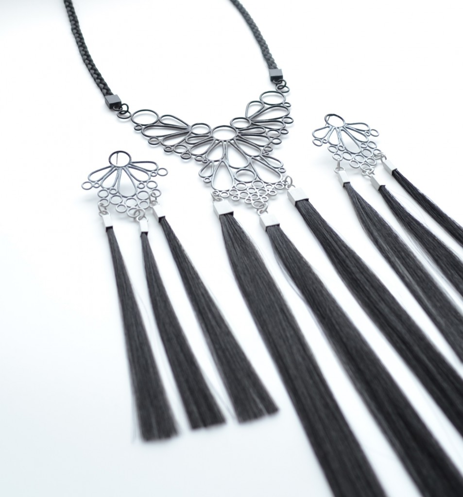 lare one of a kind necklace pwdercoated in black to grey with synthetic hair