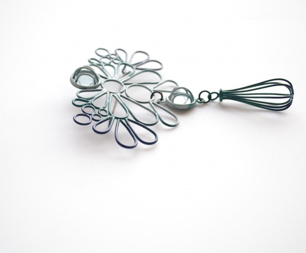 large brooch made with copper wire powdercoated in navy, emerald and slate