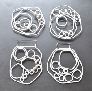 Circle brooches from 2014 collection wth white powdercoat