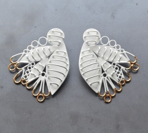 white cage feather earrings with gold leaf