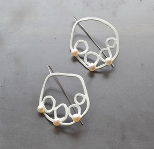 white circle earrings in white powdercoat with white pearls