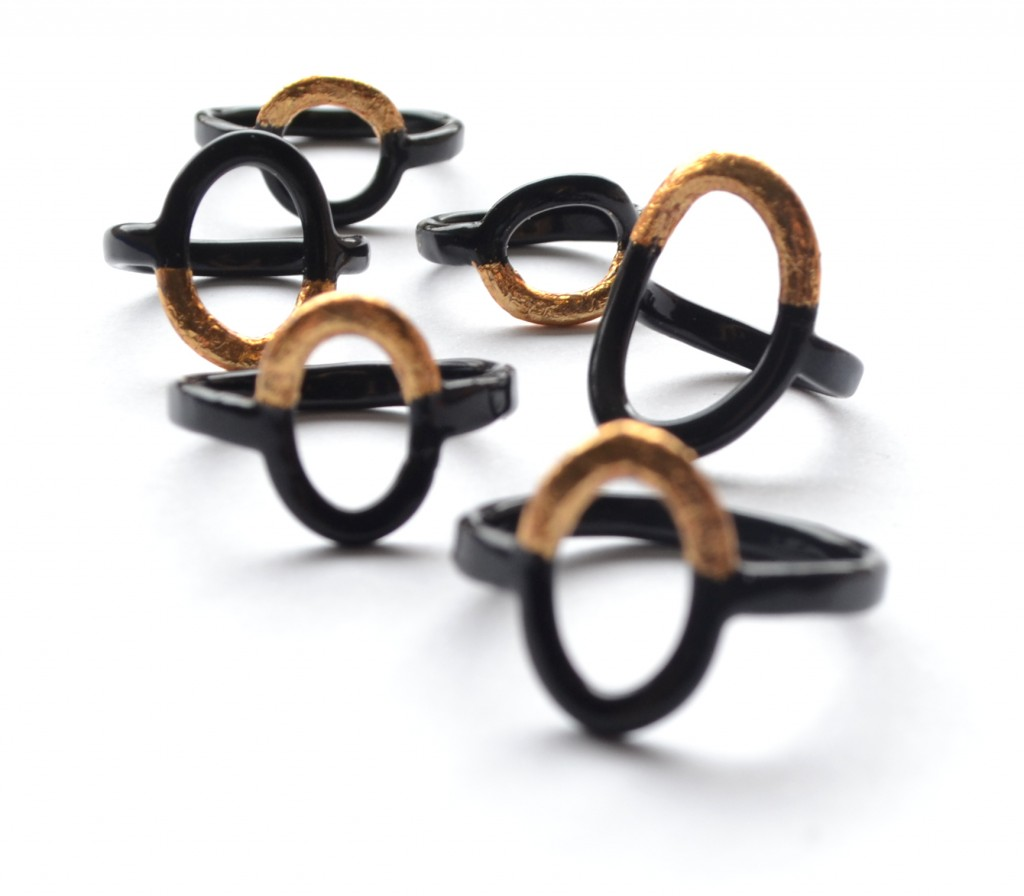 powder coat black rings with gold leaf detailing