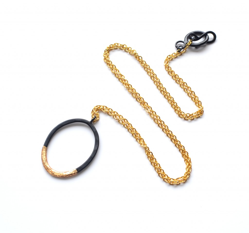 black powder coated necklace with gold leaf detailing and gold plated chain