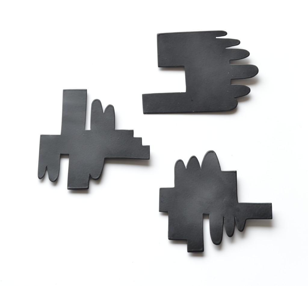 contemporary jewelry exchange brooch backs in matte black
