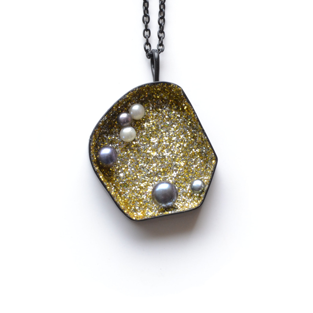 black geometric gold and silver sparkle necklace with black pearls