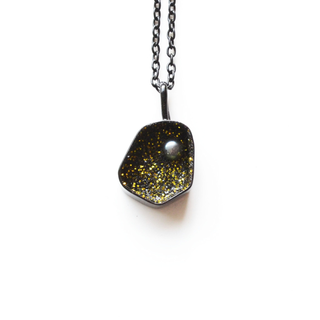 geode pendant long on black chain, with black pearl gold and silver glitter