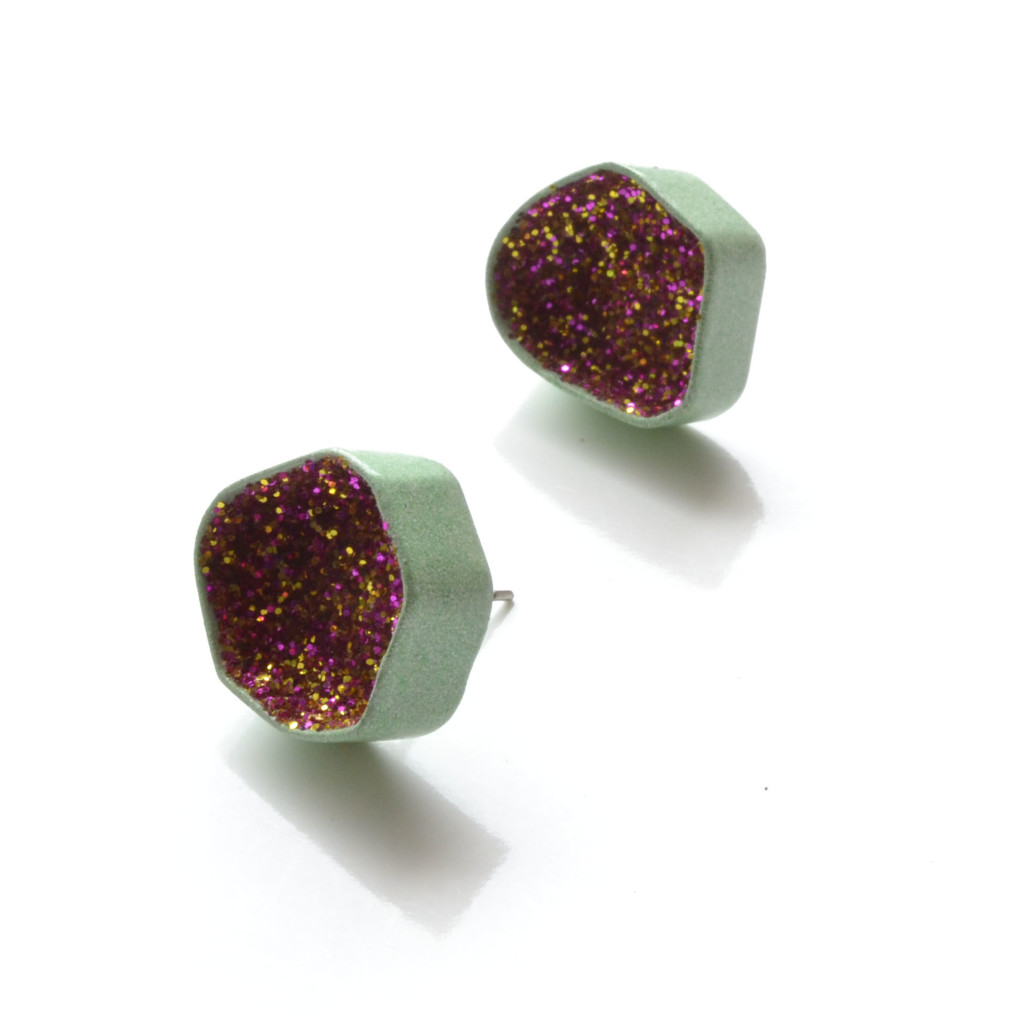 stud earrings in pastel green powder coat with gold and magenta glitter