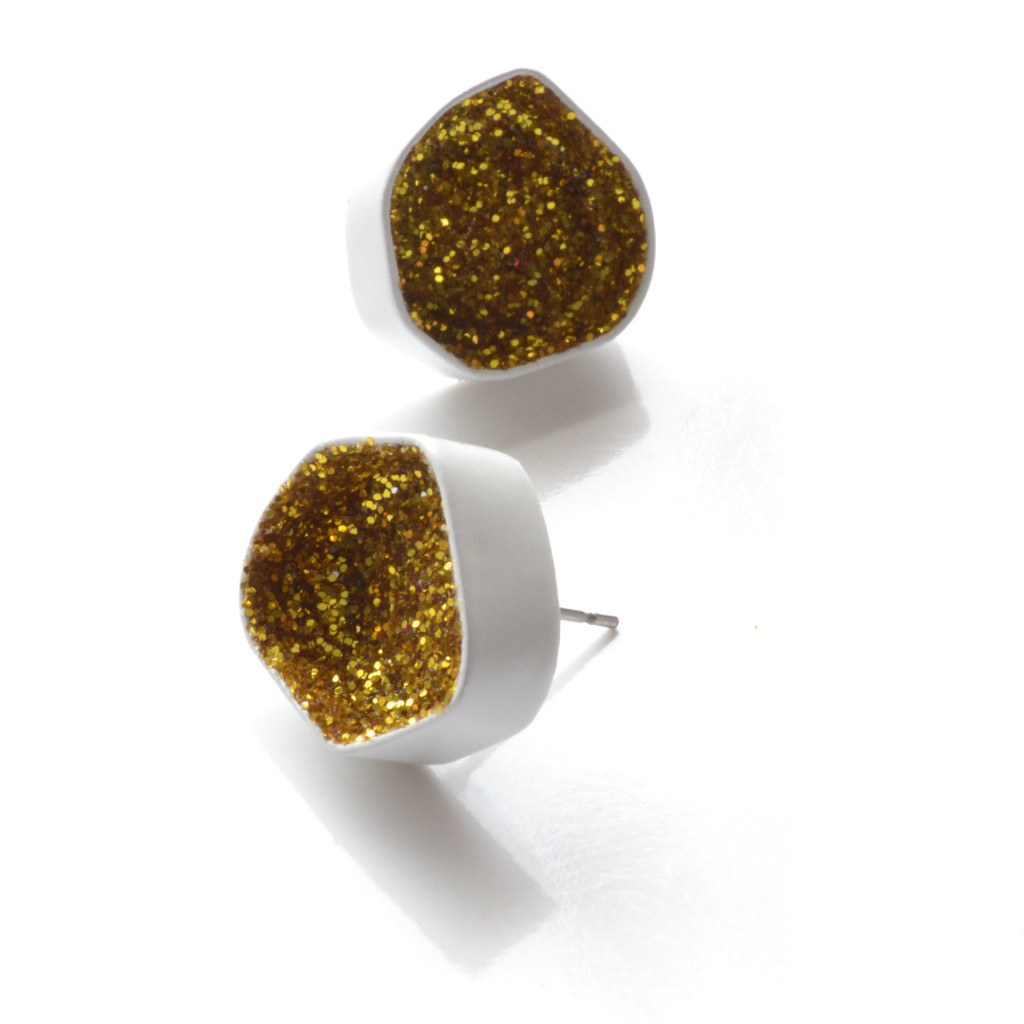 white geometric stud earrings with gold glitter
