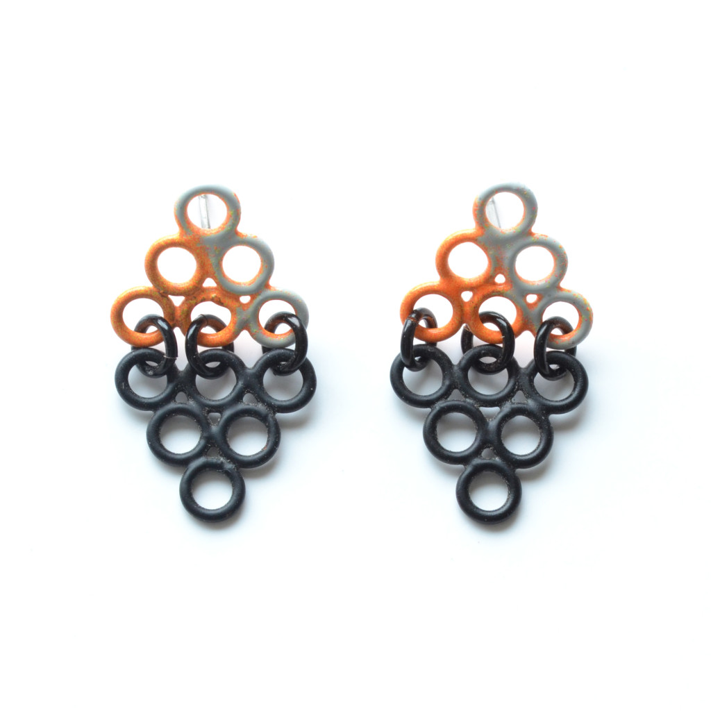 small triangle shadow earrings in matte black and orange